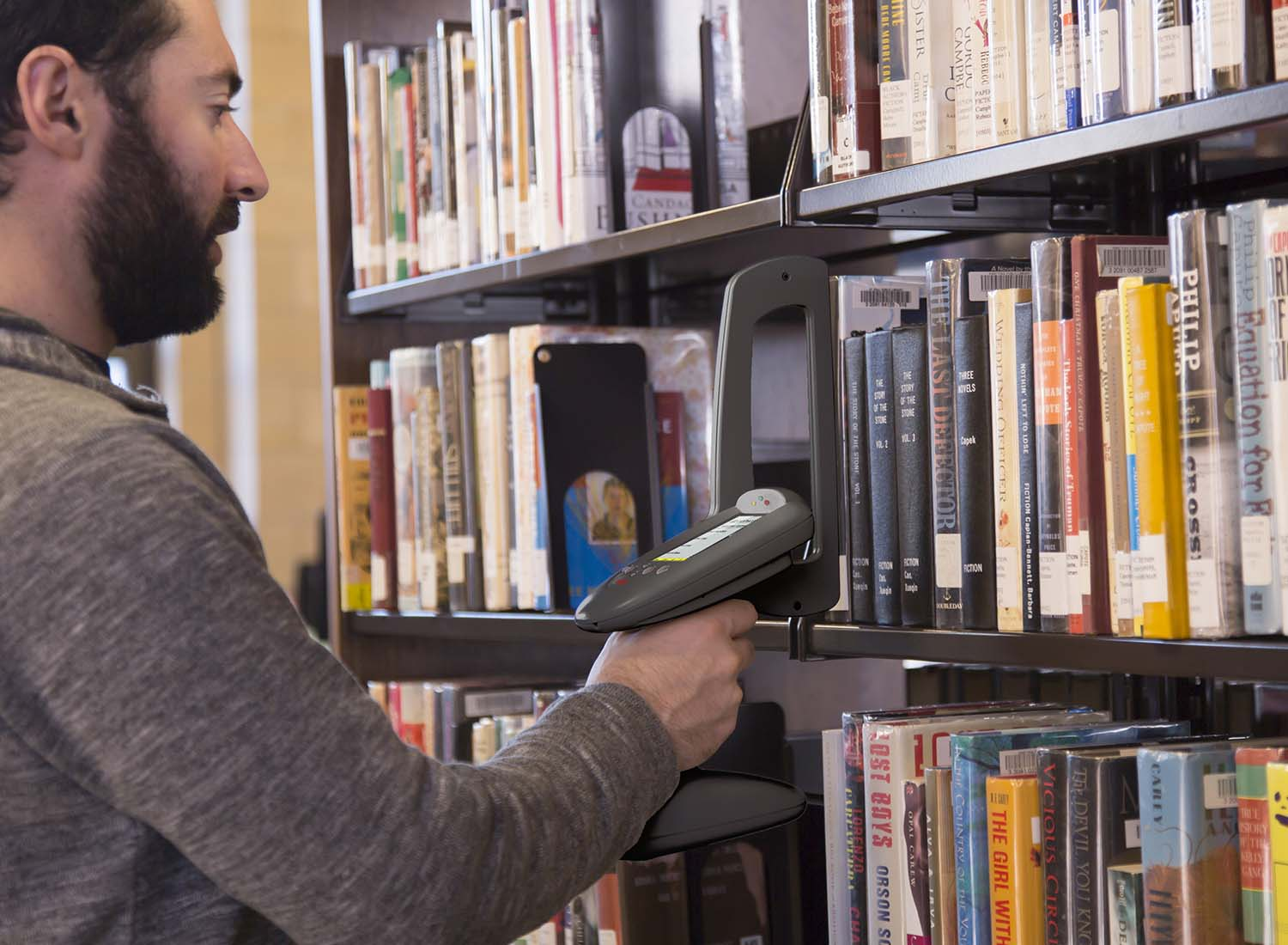 Man taking library inventory with RFID wand
