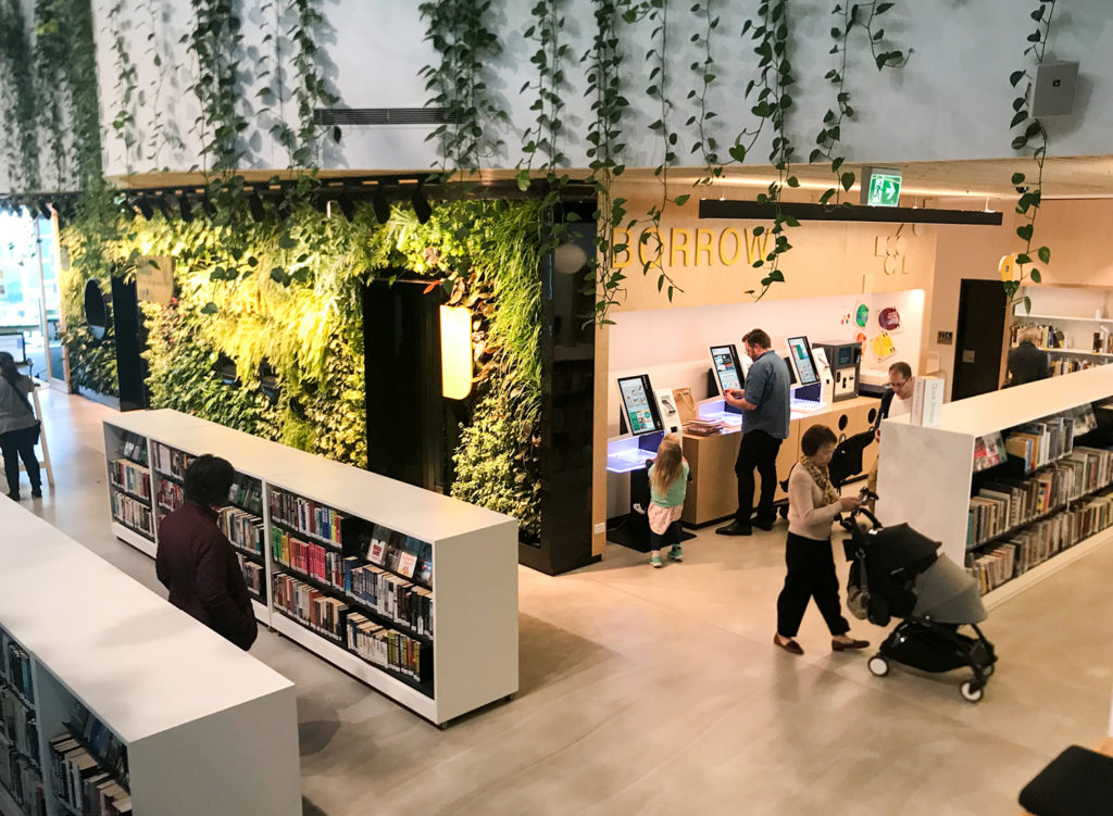 SelfCheck1000 in library with leaf wall and a jungle outdoor theme