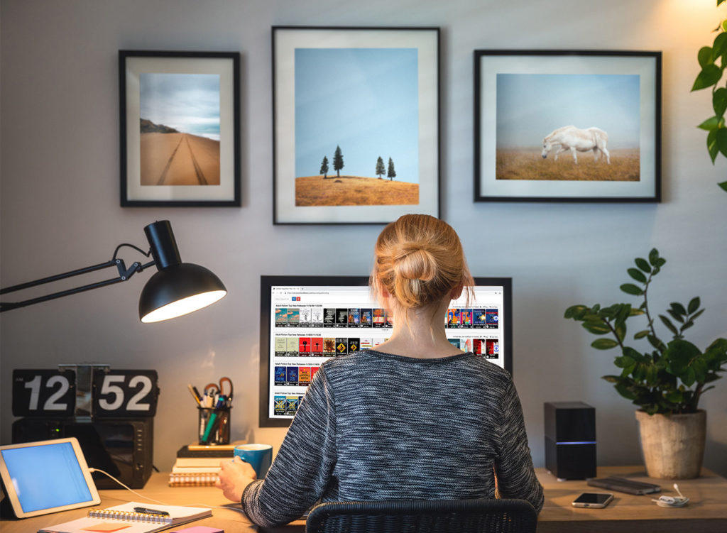 Lady on computer using cloudLibrary CAT