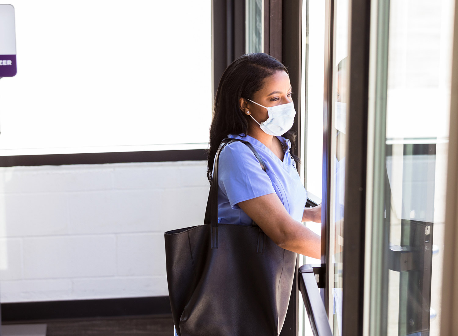 nurse walking out of building